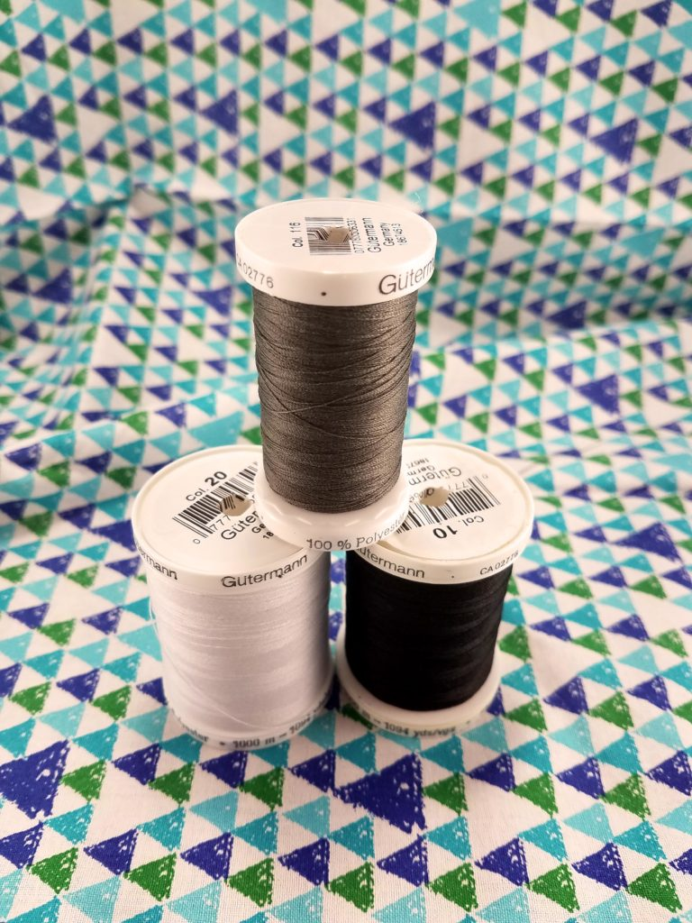 Spools of thread in a stack