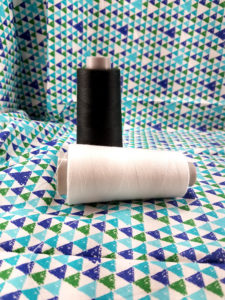 Cones of White and Black Serger Thread